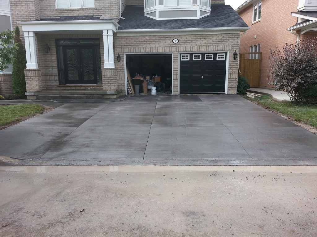 Step by step illustration of concrete installation in for New concrete driveway