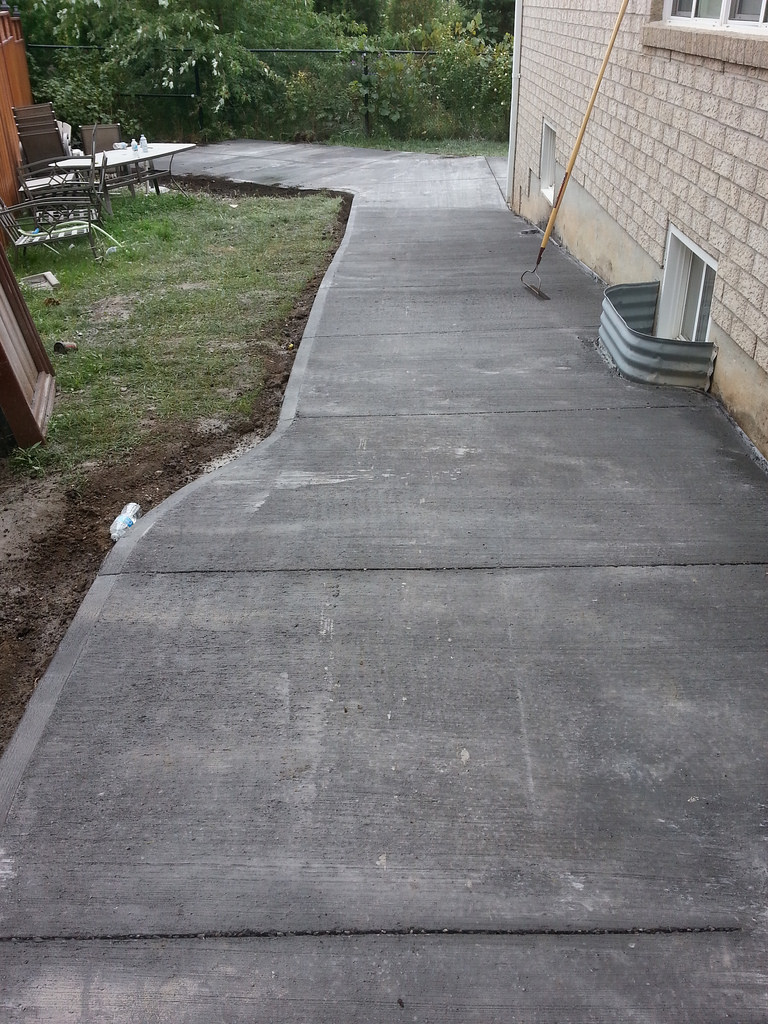 Completed installation of new Boulder colour concrete driveway