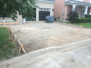 Wooden perimeter constructed for driveway
